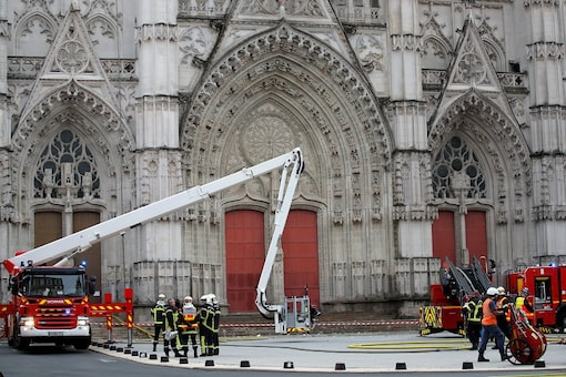French firefighters work at the scene of a blaze at the Cathedral of Saint Pierre and Saint Paul in Nantes, France. REUTERS/Stephane Mahe