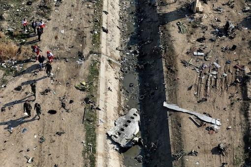 File photo of rescue workers searching the scene where a Ukrainian plane crashed in Shahedshahr, southwest of Tehran. (AP Photo/Ebrahim Noroozi, File)