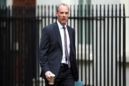 Britain's Foreign Secretary Dominic Raab arrives at Downing Street ahead of a cabinet meeting in London, Britain, July 14, 2020. REUTERS/Hannah McKay/Files