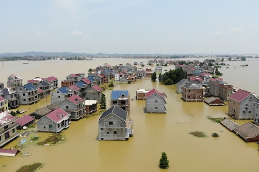 Buildings and farmlands are seen partially submerged in floodwaters following heavy rainfall in Poyang county of Jiangxi province in China.  (Representational Image: Reuters)