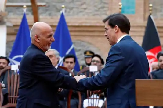 Afghanistan's President Ashraf Ghani shakes hands with US Defense Secretary Mark Esper, during a news conference in Kabul, Afghanistan. (Reuters)