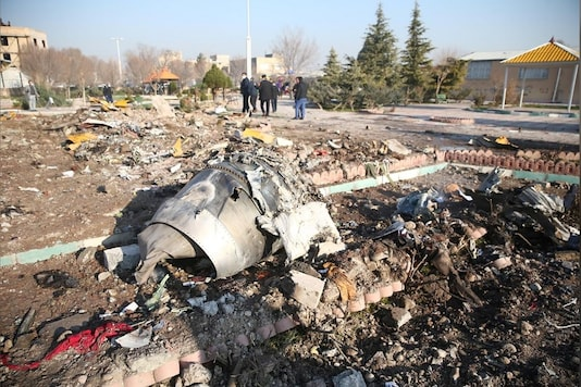 Debris of a plane belonging to Ukraine International Airlines, that crashed after taking off from Iran's Imam Khomeini airport, is seen on the outskirts of Tehran, Iran. (Image Source: Reuters)