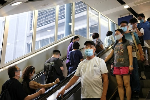 People wear protective face masks at a shopping mall following the coronavirus disease (COVID-19) outbreak in Hong Kong, China July 19, 2020. REUTERS/Tyrone Siu