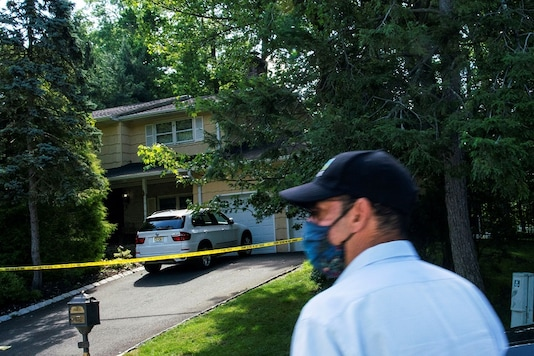 A man walks outside the home of federal judge Esther Salas, where her son was shot and killed and her defense attorney husband was critically injured, in North Brunswick, New Jersey, U.S. July 20, 2020. REUTERS/Eduardo Munoz