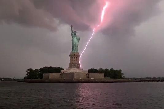 Lightning strikes illuminate the Statue of Liberty