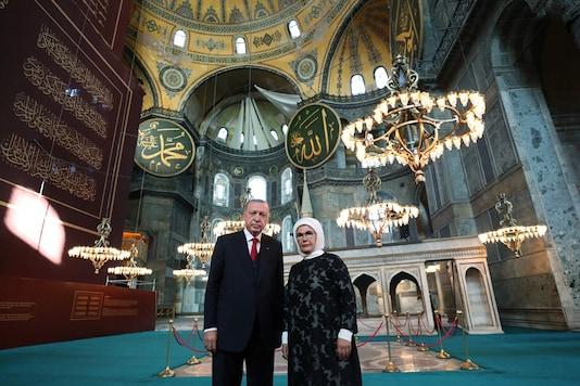 Turkey's President Tayyip Erdogan and his wife Emine Erdogan pose in the Hagia Sophia Grand Mosque in Istanbul, Turkey, July 23, 2020. (Murat Cetinmuhurdar/PPO/Handout via REUTERS)