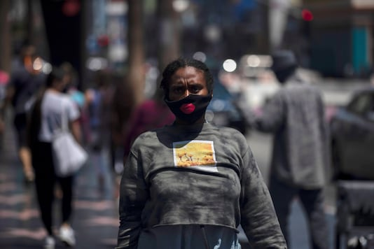 A person wearing a face mask walks on Hollywood Blvd during the outbreak of the coronavirus disease (COVID-19), in Los Angeles, California, U.S., July 24, 2020. REUTERS/Mario Anzuoni