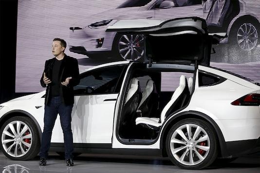 Tesla CEO Elon Musk alongside a Tesla Model X. (Photo: Reuters)