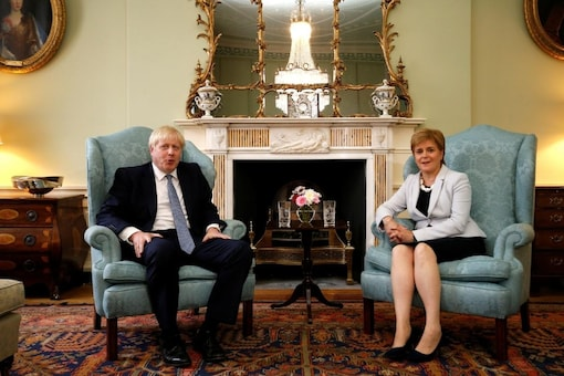 Britain's Prime Minister Boris Johnson poses for a photograph with Scotland's First Minister Nicola Sturgeon at Bute House in Edinburgh, Britain, July 29, 2019. Duncan McGlynn/Pool via REUTERS
