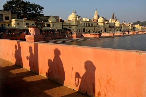 In this November 11, 2019 file photo, devotees pray while walking towards a temple, in Ayodhya. (AP Photo/Rajesh Kumar Singh)