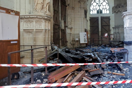 File photo of debris caused by a fire inside the Cathedral of Saint Pierre and Saint Paul in Nantes, France on July 18. (Reuters)