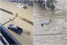 Gone with the Wave: Man Smoothly Floats on Flowing Water as Heavy Rain Floods Karachi Roads