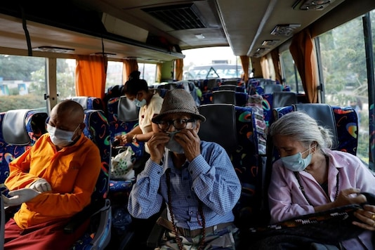 File photo: Masked stranded residents of Ladakh, a union territory in India, seat in a bus which will take them back to Ladakh, after few restrictions were lifted by Delhi government during an extended nationwide lockdown to slow the spread of the coronavirus disease (COVID-19), in New Delhi, India, May 11, 2020. REUTERS/Anushree Fadnavis