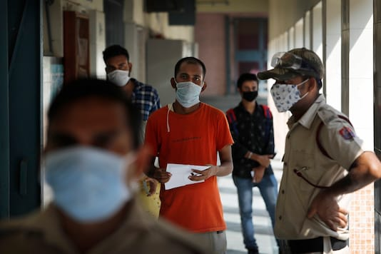 People wait to give their nasal swab samples for COVID-19 test in New Delhi, India, Tuesday, July 28, 2020. India is the third hardest-hit country by the pandemic in the world after the United States and Brazil. (Image: AP Photo/Manish Swarup)