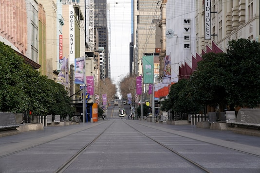 Bourke Street mall, a normally busy shopping hub in Melbourne, is seen devoid of people after the city re-entered Stage 3 restrictions as part of efforts to curb a resurgence of the coronavirus disease on July 23, 2020. (REUTERS/Sandra Sanders)