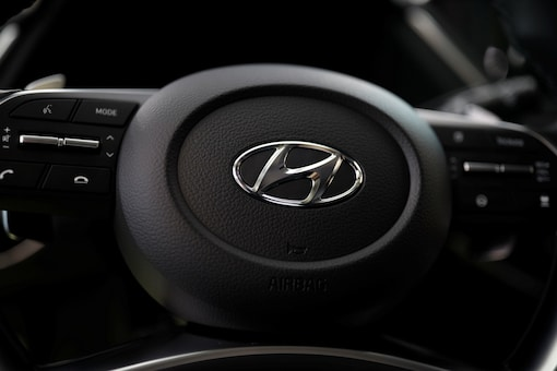 The logo of Hyundai Motors is seen on a steering wheel of a car. (Image Source: Reuters)