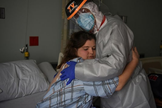 Dr. Joseph Varon, 58, the chief medical officer at United Memorial Medical Center, hugs Christina Mathers, 43, a nurse from his team who became infected with COVID-19, at United Memorial Medical Center (UMMC), during the coronavirus disease (COVID-19) outbreak, in Houston, Texas, U.S. (Reuters/Callaghan O'Hare)