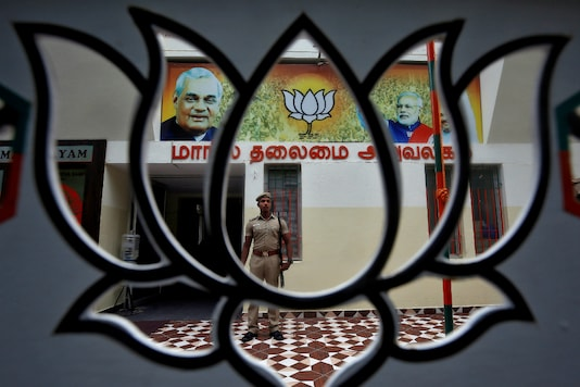 A police officer stands guard inside a BJP office after Supreme Court's verdict on Ayodhya, in Chennai. (Reuters File Photo)