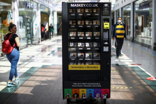 A vending machine that sells protective masks is seen in a shopping centre, following the coronavirus disease (COVID-19) outbreak, in Ilford, London, Britain July 29, 2020. REUTERS/Hannah McKay