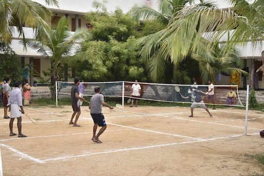 Covid-19 infectted persons enjoy a game of badminton at a centre in Ananthapur district.
