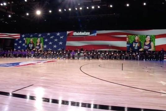 NBA players take a knee (Photo Credit: Twitter)