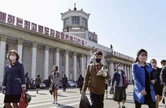 North Korea steps up curbs after first possible coronavirus infection