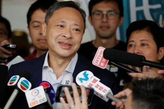 Hong Kong University sacks veteran democracy activist