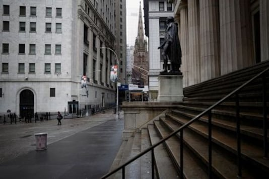Upbeat earnings lift Wall Street as focus shifts to Fed