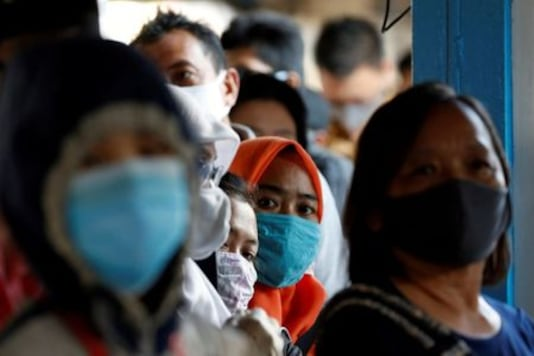 Indonesia reports 1,904 new coronavirus cases as capital city extends restrictions