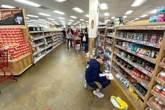 U.S. consumer spending presses ahead; declining income poses challenge