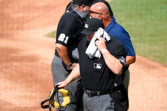 Umpire Joe West leaves game after hit by flying baseball bat