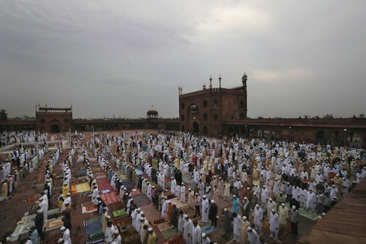 Indian Muslims wear face mask as a precaution against coronavirus offer Eid al-Adha prayer at the Jama Masjid in New Delhi, India, Saturday, Aug.1, 2020. Eid al-Adha, or the Feast of the Sacrifice, by sacrificing animals to commemorate the prophet Ibrahim's faith in being willing to sacrifice his son. (AP Photo/Manish Swarup)