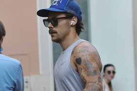 Harry Styles Flaunts His Quarantine Moustache as He Steps Out on the Streets of Italy for a Jog