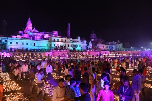 People light lamps in Ayodhya on Tuesday evening.