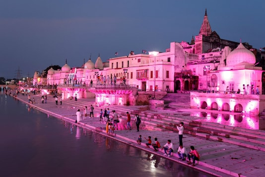 Temples and other buildings are illuminated on the banks of the Saryu River in Ayodhya. (Reuters)