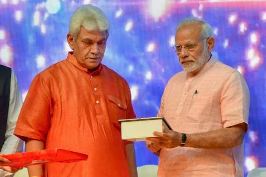 Former Union minister Manoj Sinha with PM Modi. (PTI File)
