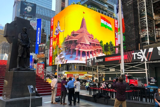 Imagery of the Hindu deity Ram and 3-D portraits of the proposed Hindu temple are displayed on a digital billboard in Times Square, Wednesday, Aug. 5, 2020, to celebrate the groundbreaking ceremony of a temple dedicated to the Lord Rama by Prime Minister Narendra Modi in Ayodhya. (AP Photo/Ted Shaffrey)