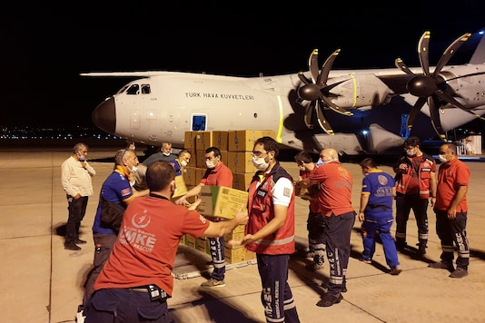 Several countries have pledged to help Lebanon in tiding over the crisis after the blast that hit Beirut. In this photo, Turkish officials load medical supplies and aid to be sent to Lebanon. (Credit: AP)