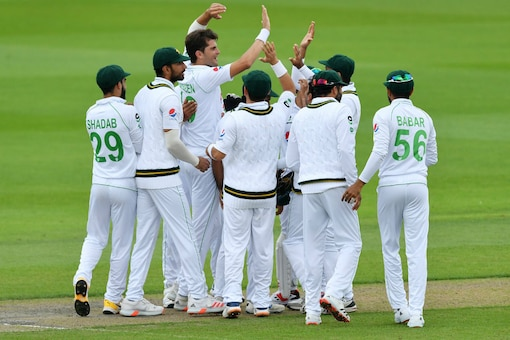Pakistan cricket team celebrate the fall of an England wicket (Image: AP)