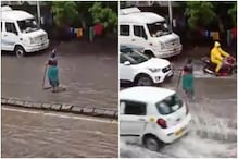 Mumbai Woman Stands on Waterlogged Road for Hours in Rain to Warn Commuters of Open Manhole
