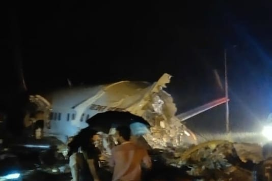 Rescue workers at the site of the crash in Kozhikode on Friday.