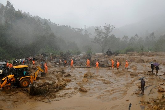 Rescuers work at the site of a mudslide triggered by heavy monsoon rain in Idukki district, Kerala, Friday, Aug. 7, 2020. (AP Photo)