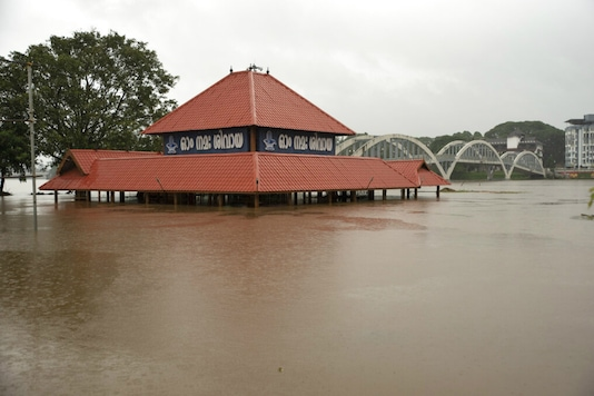 The Aluva Shiva temple stands partially submerged in water after the Periyar river overflowed following heavy monsoon rains in Kochi, Kerala. (AP)