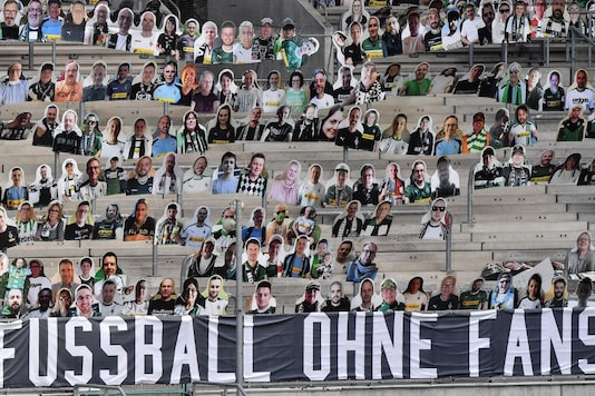 German football fans' cardboard cutouts in stadium. (Photo Credit: AP)