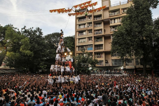 File photo: Devotees form a human pyramid to break a clay pot containing curd during the Hindu festival of Janmashtami, marking the birth anniversary of Hindu Lord Krishna, in Mumbai. (Reuters)