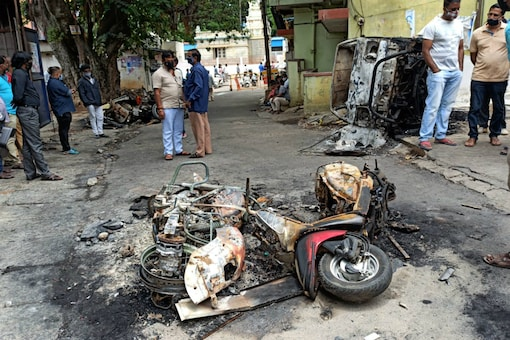 File photo: The damaged vehicles in Bengaluru during violence.