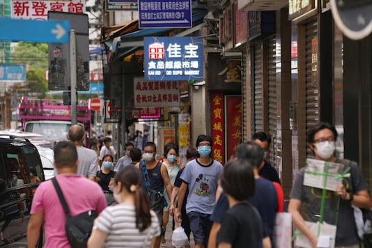 People wearing face masks walk on a street following the coronavirus disease (COVID-19) outbreak, in Hong Kong, China August 11, 2020. REUTERS/Lam Yik