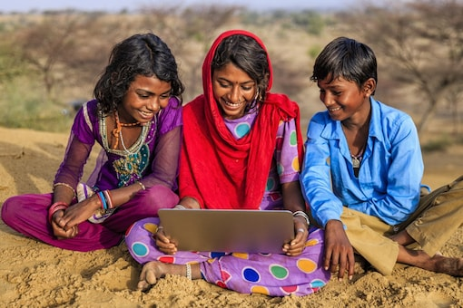 File photo of first time internet users in India experiencing a tablet.