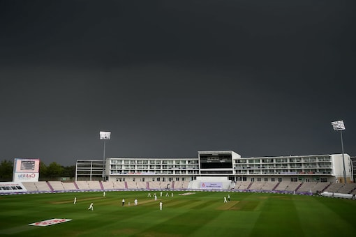 Dark clouds just before the rain delay on Day 1 (Image: AP)
