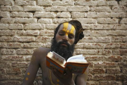 A sadhu recites the holy book of Ramayana. (Reuters)